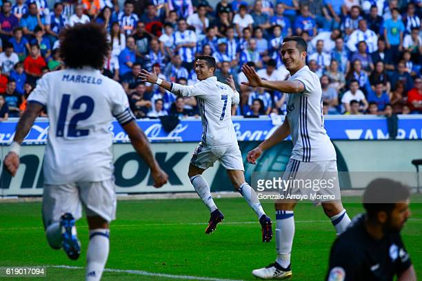 Cristiano Ronaldo of Real Madrid CF celebrates scoring their fourth goal during the La Liga match between Deportivo Alaves and Real Madrid CF at...