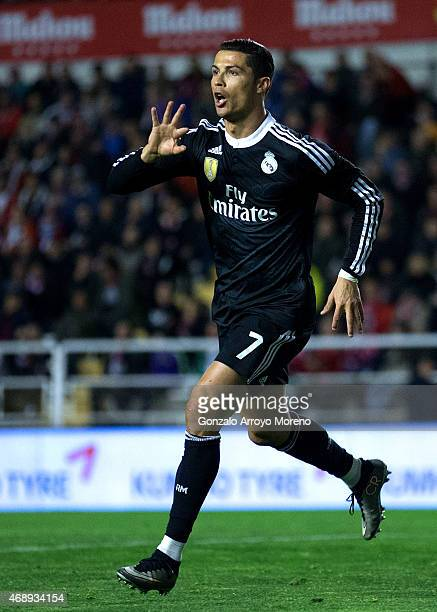 Cristiano Ronaldo of Real Madrid CF celebrates scoring their opening goal during the La Liga match between Rayo Vallecano de Madrid and Real Madrid...