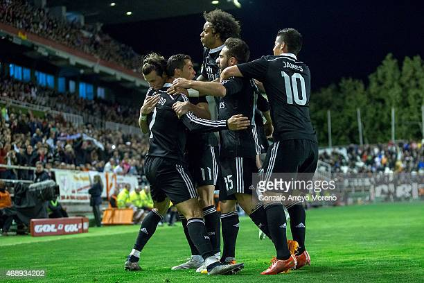 Cristiano Ronaldo of Real Madrid CF celebrates scoring their opening goal with teammates during the La Liga match between Rayo Vallecano de Madrid...