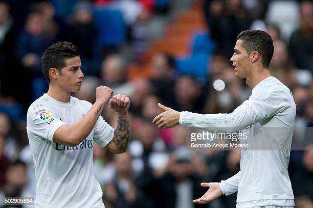 Cristiano Ronaldo of Real Madrid CF celebrates scoring their opening goal with teammate James Rodriguez during the La Liga match between Real Madrid...