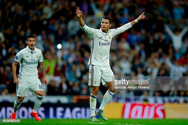 Cristiano Ronaldo of Real Madrid CF celebrates scoring their opening goal during the UEFA Champions League group stage match between Real Madrid CF...