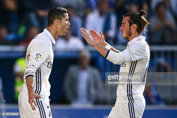 Cristiano Ronaldo of Real Madrid CF celebrates scoring their opening goal with team mate Gareth Bale during the La Liga match between Deportivo...