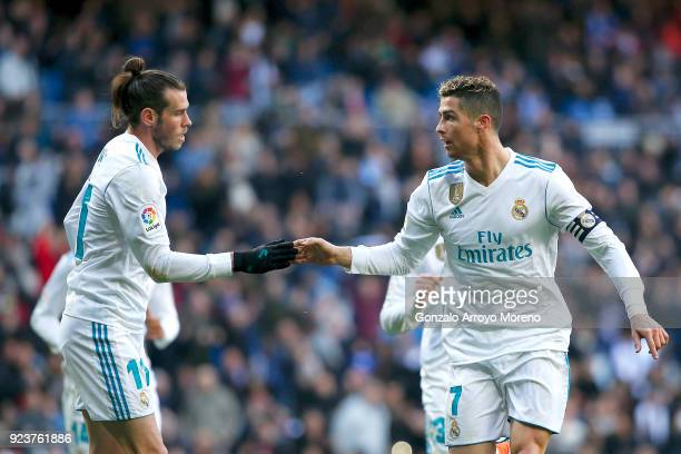 Cristiano Ronaldo of Real Madrid CF celebrates scoring their opening goal with teammate Gareth Bale during the La Liga match between Real Madrid CF...