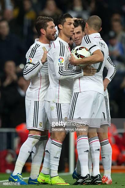 Cristiano Ronaldo of Real Madrid CF celebrates scoring their second goal with teammates Gareth Bale Karim Benzema and Sergio Ramos during tha La Liga...