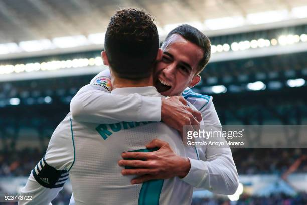 Cristiano Ronaldo of Real Madrid CF celebrates scoring their second goal with teammate Lucas Vazquez during the La Liga match between Real Madrid CF...