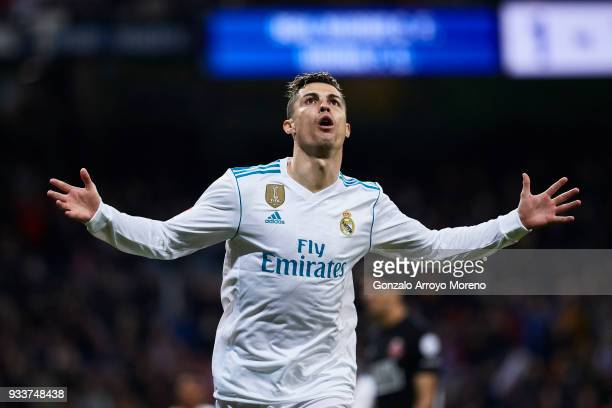 Cristiano Ronaldo of Real Madrid CF celebrates scoring their second goal during the La Liga match between Real Madrid CF and Girona FC at Estadio...