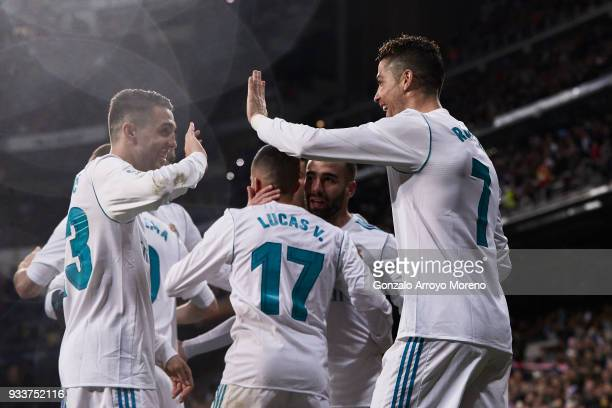 Cristiano Ronaldo of Real Madrid CF celebrates scoring their second goal with teammates Mateo Kovacic and Lucas Vazquez during the La Liga match...