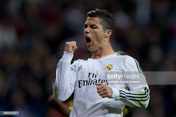 Cristiano Ronaldo of Real Madrid CF celebrates scoring their third goal during the La Liga match between Real Madrid CF and Sevilla FC at Estadio...