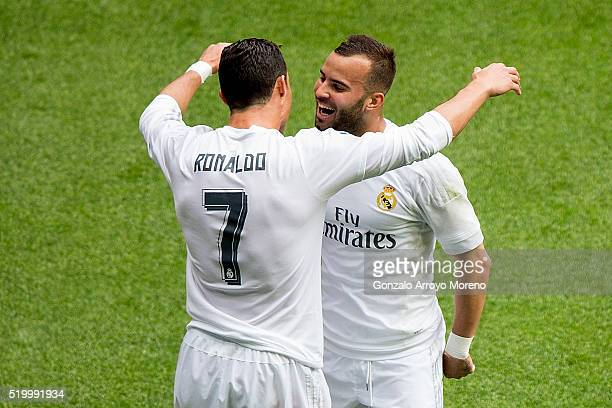 Cristiano Ronaldo of Real Madrid CF celebrates scoring their third goal with teammate Jese Rodriguez during the La Liga match between Real Madrid CF...