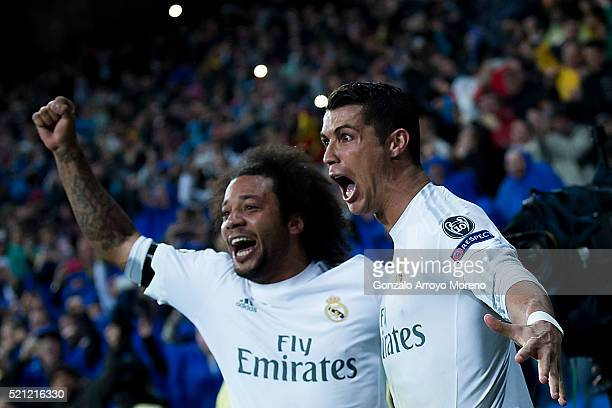 Cristiano Ronaldo of Real Madrid CF celebrates scoring their third goal with teammate Marcelo during the UEFA Champions League quarter final second...