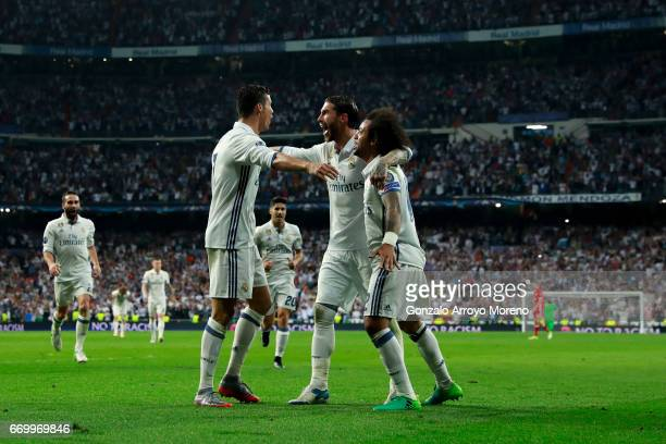 Cristiano Ronaldo of Real Madrid CF celebrates scoring their third goal with teammates Sergio Ramos and Marcelo during the UEFA Champions League...