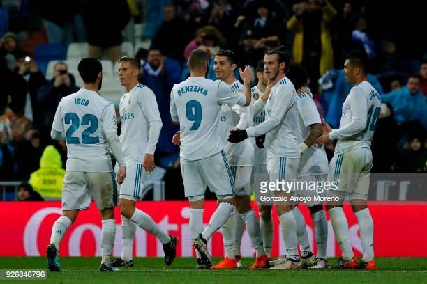 Cristiano Ronaldo of Real Madrid CF celebrates scoring their third goal with teammates Karim Benzema and Gareth Bale during the La Liga match between...