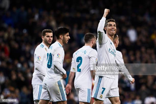Cristiano Ronaldo of Real Madrid CF celebrates scoring their third goal with teammates during the La Liga match between Real Madrid CF and Girona FC...