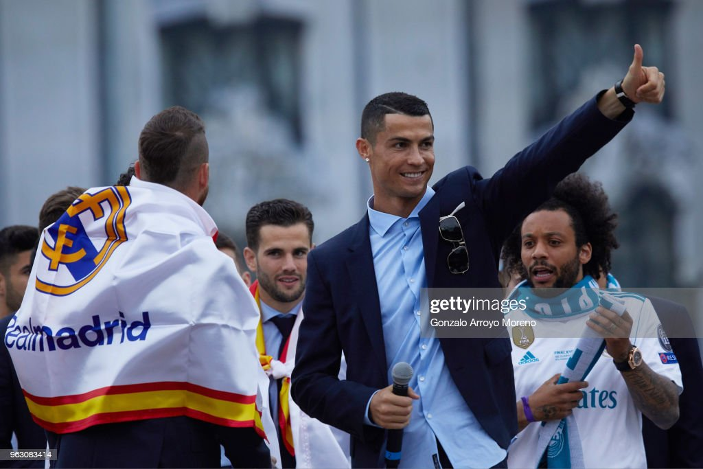Cristiano Ronaldo of Real Madrid CF celebrates their Champions League victory with teammates Sergio Ramos (L); Nacho Fernandez (2ndL) and Marcelo (R) at Cibeles Square a day after winning their 13th European Cup and UEFA Champions League Final on May 27, 2018 in Madrid, Spain.