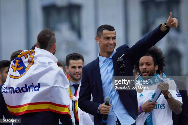 Cristiano Ronaldo of Real Madrid CF celebrates their Champions League victory with teammates Sergio Ramos Nacho Fernandez and Marcelo at Cibeles...