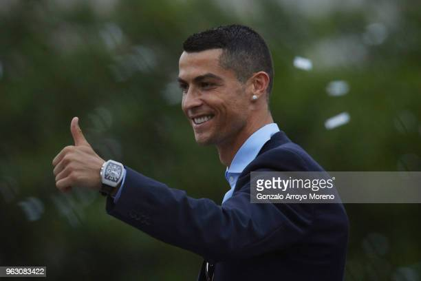 Cristiano Ronaldo of Real Madrid CF celebrates their Champions League victory at Cibeles Square a day after winning their 13th European Cup and UEFA...