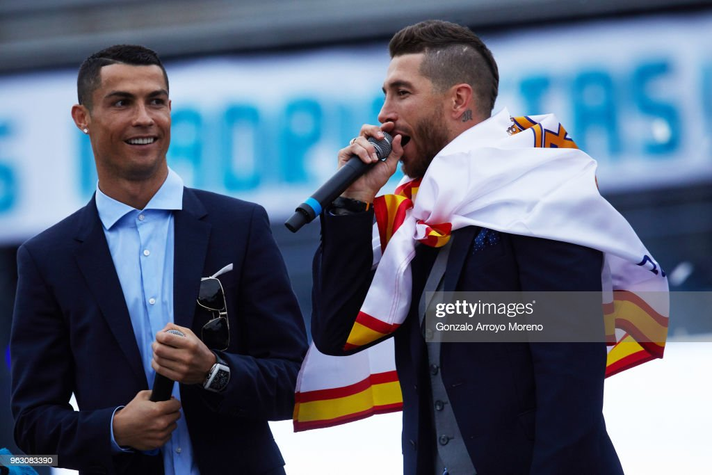 Cristiano Ronaldo (L) of Real Madrid CF celebrates their trophy with teammate Sergio Ramos (R) at Cibeles Square a day after winning their 13th European Cup and UEFA Champions League Final on May 27, 2018 in Madrid, Spain.