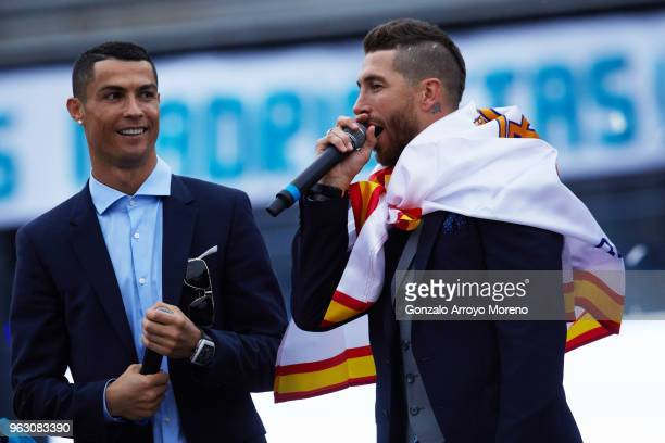 Cristiano Ronaldo of Real Madrid CF celebrates their trophy with teammate Sergio Ramos at Cibeles Square a day after winning their 13th European Cup...