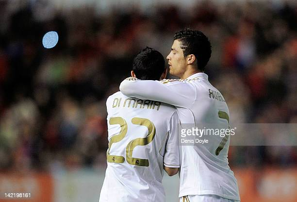 Cristiano Ronaldo of Real Madrid CF celebrates with Angel di Maria after Real beat CA Osasuna 51 during the La Liga match between CA Osasuna and Real...