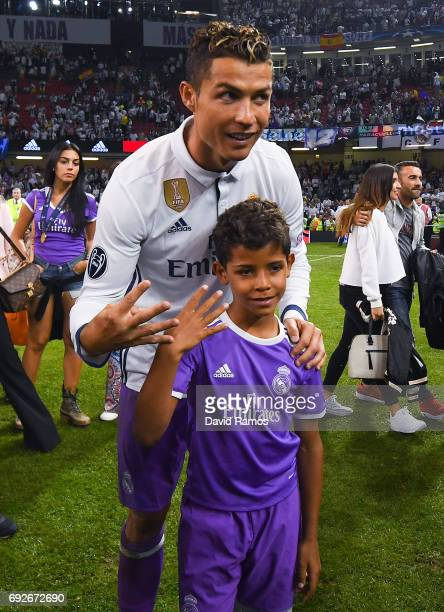 Cristiano Ronaldo of Real Madrid CF celebrates with his son Cristiano Ronaldo Jr after the UEFA Champions League Final between Juventus and Real...