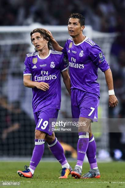 Cristiano Ronaldo of Real Madrid CF celebrates with his team mate Luka Modric after scoring his team's third goal during the UEFA Champions League...