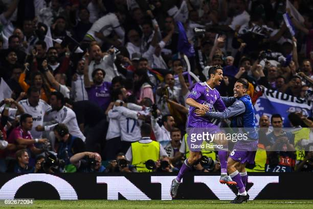 Cristiano Ronaldo of Real Madrid CF celebrates with his team mates after scoring his team's third goal during the UEFA Champions League Final between...