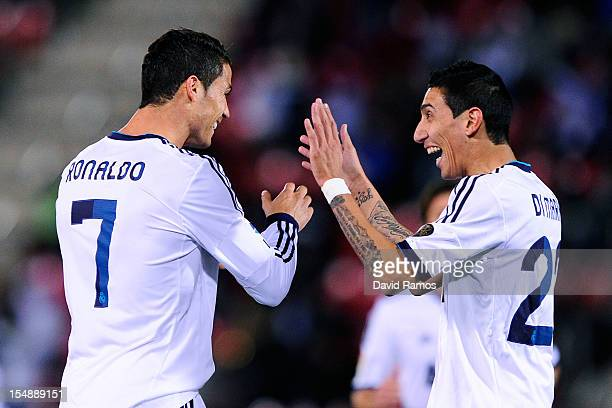 Cristiano Ronaldo of Real Madrid CF celebrates with his teammate Angel Di Maria of Real Madrid CF after scoring his team's second goal during the La...