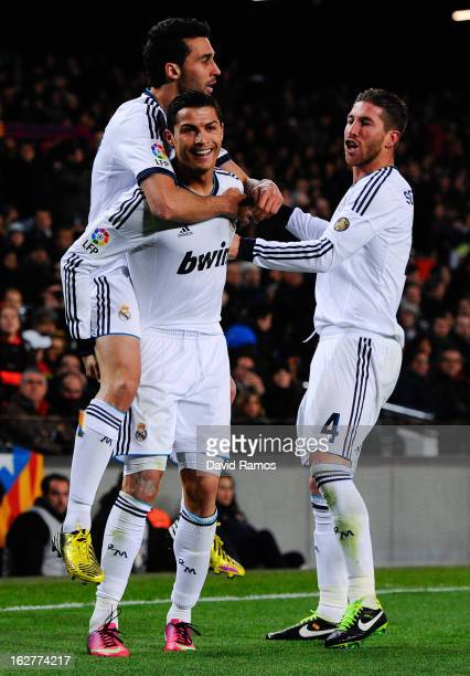 Cristiano Ronaldo of Real Madrid CF celebrates with his team-mates Alvaro Arbeloa and Sergio Ramos after scoring their second goal during the Copa...