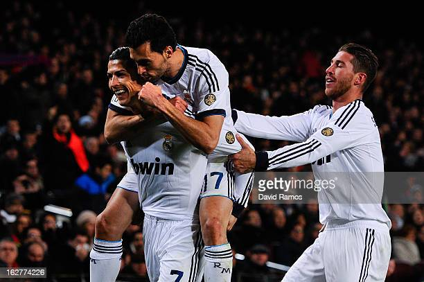 Cristiano Ronaldo of Real Madrid CF celebrates with his team-mates Alvaro Arbeloa and Sergio Ramos after scoring his team's their goal during the...