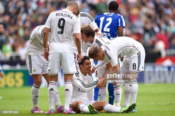 Cristiano Ronaldo of Real Madrid CF celebrates with his teammates after scoring the opening goal during the La Liga match between RC Deportivo La...