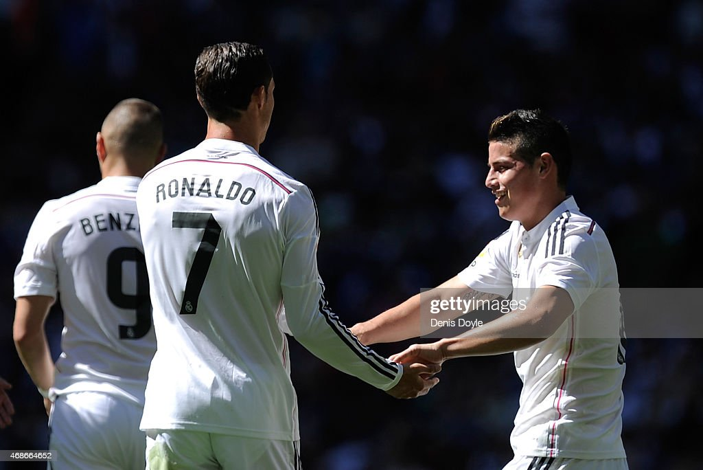 Cristiano Ronaldo of Real Madrid CF celebrates with James Rodriguez after scoring his team's 4th goal during the La Liga match between Real Madrid CF and Granada CF at Estadio Santiago Bernabeu on April 5, 2015 in Madrid, Spain.