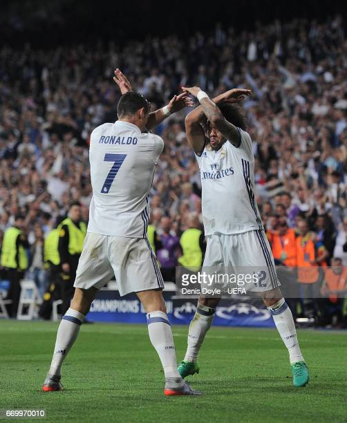 Cristiano Ronaldo of Real Madrid CF celebrates with Marcelo after scoring his 3rd goal during the UEFA Champions League Quarter Final second leg...