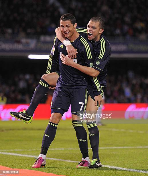 Cristiano Ronaldo of Real Madrid CF celebrates with Pepe after scoring Real's opening goal during the La Liga match between RC Celta de Vigo and Real...
