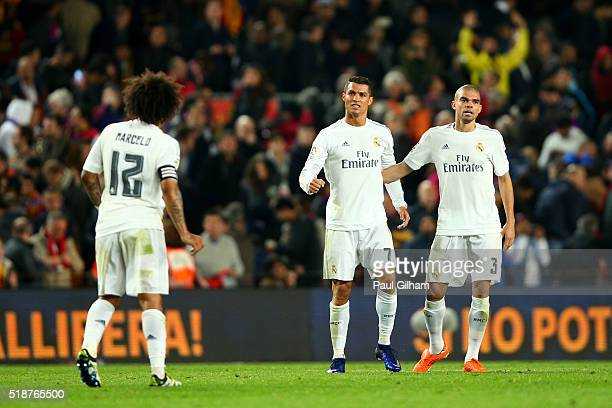 Cristiano Ronaldo of Real Madrid CF celebrates with Pepe and Marcelo of Real Madrid CF after the La Liga match between FC Barcelona and Real Madrid...