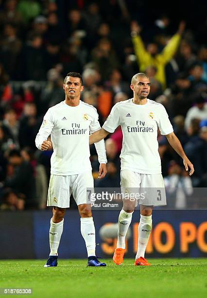 Cristiano Ronaldo of Real Madrid CF celebrates with Pepe of Real Madrid CF during the La Liga match between FC Barcelona and Real Madrid CF at Camp...