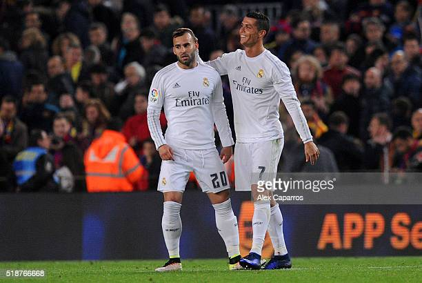 Cristiano Ronaldo of Real Madrid CF celebrates with teammate Jese after the La Liga match between FC Barcelona and Real Madrid CF at Camp Nou on...