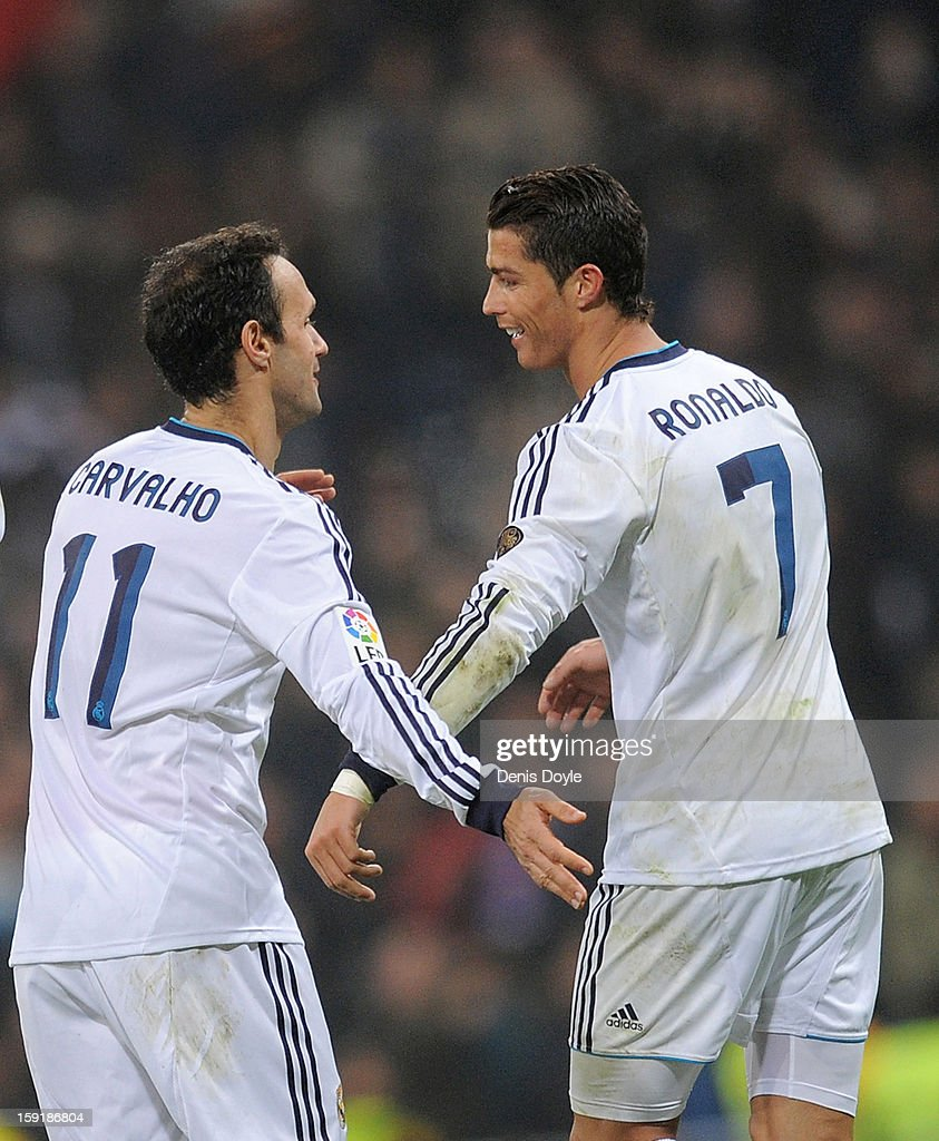 Cristiano Ronaldo (R) of Real Madrid CF celebrates with teammate Ricardo Carvalho after scoring Real's 3rd goal during the Copa del Rey round of 16 second leg match between Real Madrid and Celta de Vigo at Estadio Santiago Bernabeu on January 9, 2013 in Madrid, Spain.