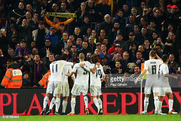 Cristiano Ronaldo of Real Madrid CF celebrates with teammates after scoring their second goal during the La Liga match between FC Barcelona and Real...