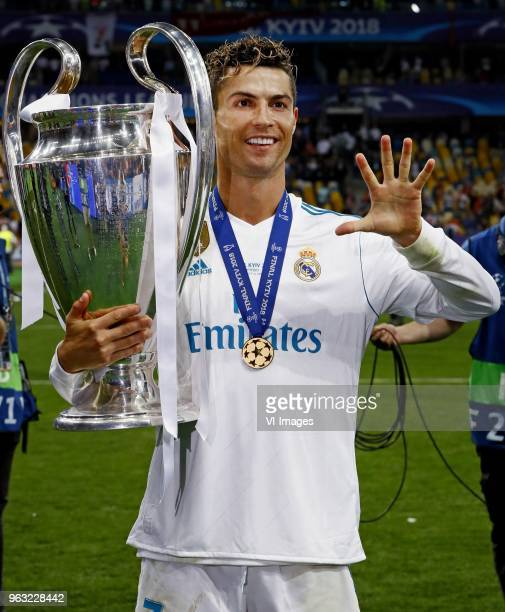 Cristiano Ronaldo of Real Madrid CF celebrating his fifth Champions League trophy during the UEFA Champions League final between Real Madrid and...