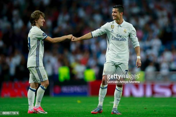 Cristiano Ronaldo of Real Madrid CF clashes knuckles with his teammate Luka Modric after the UEFA Champions League Quarter Final second leg match...