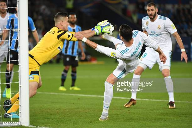 Cristiano Ronaldo of Real Madrid CF compete for the ball with Marcelo Grohe of Gremio FBPA on December 16 2017 in Abu Dhabi United Arab Emirates