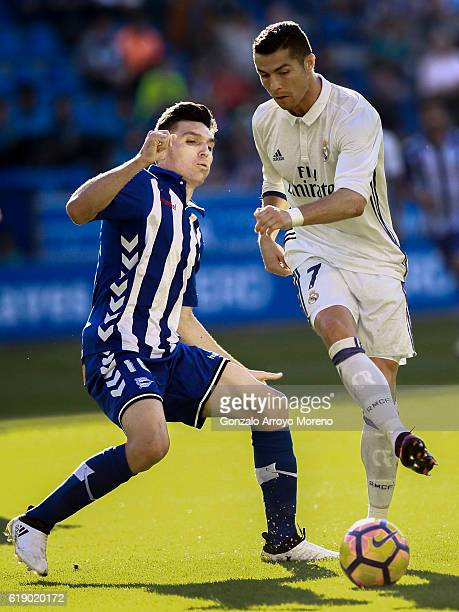 Cristiano Ronaldo of Real Madrid CF competes for the ball with Daniel Torres of Deportivo Alaves during the La Liga match between Deportivo Alaves...