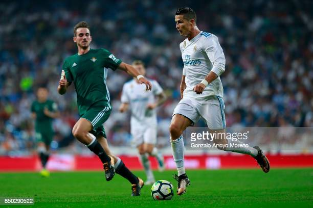 Cristiano Ronaldo of Real Madrid CF competes for the ball with Fabian Ruiz of Real Betis Balompie during the La Liga match between Real Madrid CF and...