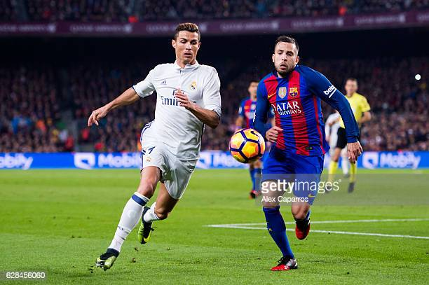 Cristiano Ronaldo of Real Madrid CF competes for the ball with Jordi Alba of FC Barcelona during the La Liga match between FC Barcelona and Real...