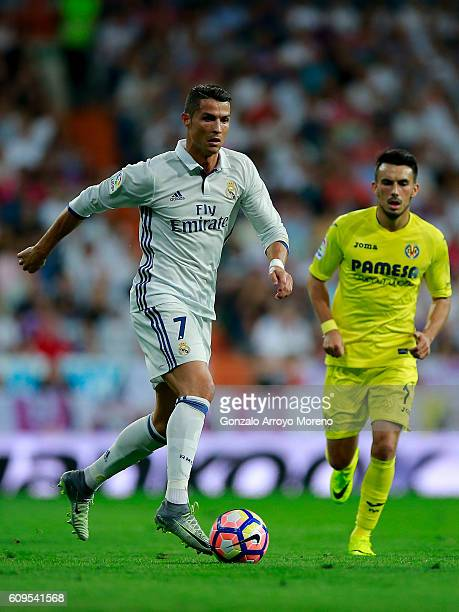 Cristiano Ronaldo of Real Madrid CF competes for the ball with Nicola Sansone of Villarreal CFduring the La Liga match between Real Madrid CF and...