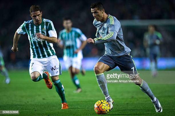 Cristiano Ronaldo of Real Madrid CF competes for the ball with Joaquin Sanchez of Real Betis Balompie during the La Liga match between Real Betis...