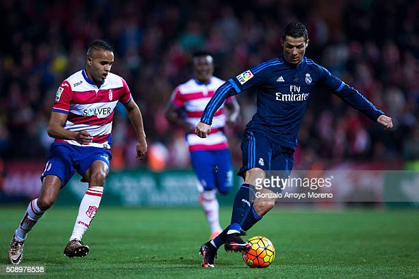 Cristiano Ronaldo of Real Madrid CF competes for the ball with Youssef ElArabi of Granada CF during the La Liga match between Granada CF and Real...