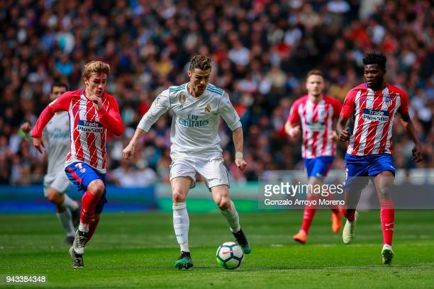 Cristiano Ronaldo of Real Madrid CF competes for the ball with Antoine Griezmann of Atletico de Madrid during the La Liga match between Real Madrid...