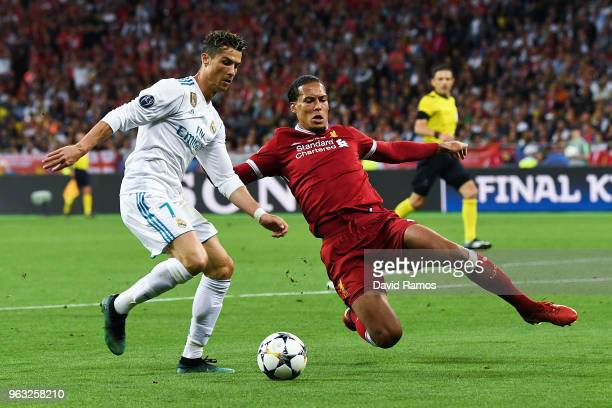 Cristiano Ronaldo of Real Madrid CF competes for the ball with Virgil van Dijk of Leicester City FC during the UEFA Champions League final between...