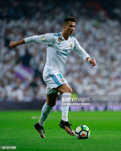 Cristiano Ronaldo of Real Madrid CF controls the ball during the La Liga match between Real Madrid CF and Real Betis Balompie at Estadio Santiago...